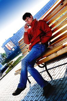 Free Student Sitting On Bench In Town Stock Photos - 5142423