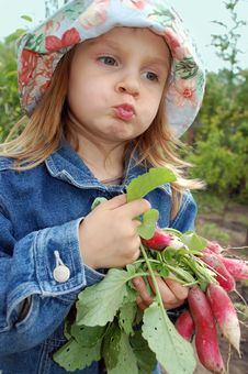 Free Little Girl With Radishes Stock Photography - 5142682
