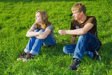 Young Couple On The Grass Stock Photo