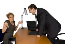 Businesswoman And Businessman In Office. Royalty Free Stock Photo