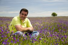 Free Man Sit In A Flower Field Stock Images - 5146534