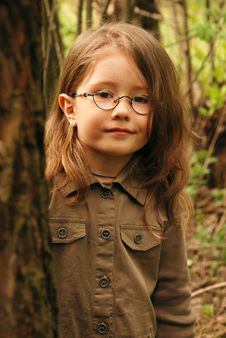 Free Little Girl And A Tree Stock Photo - 5152990