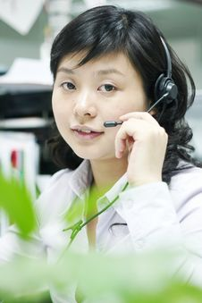 Chinese Operator With Headset Stock Photography