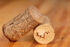 Free Two Wine Corks Resting On A Wood Surface Royalty Free Stock Images - 5159439