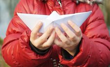 Free Hands Holding A Paper Boat Closeup Outside Stock Photography - 51596512