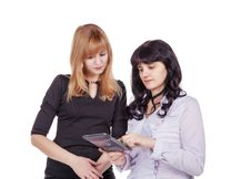 Free Two Women Looking At The Display Of The Tablet Isolated On White Royalty Free Stock Image - 51597566