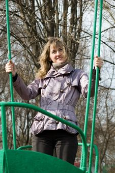 Girl In Park On Old Swing Stock Photography