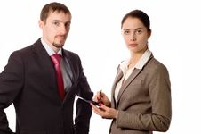 Free Young Business Man And Woman Working On A Pda Royalty Free Stock Image - 5170226
