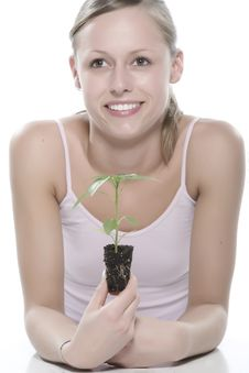 Free Young Woman Holding Young Sprout In The Hands. Stock Image - 5172391