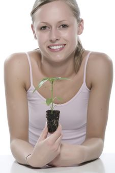 Free Young Woman Holding Young Sprout In The Hands. Stock Images - 5172424