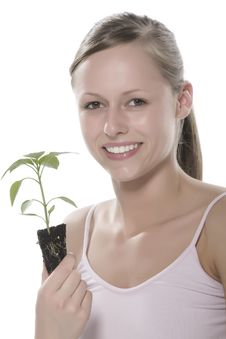 Free Young Woman Holding Young Sprout In The Hands. Stock Image - 5172571