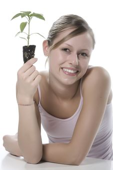Young Woman Holding Young Sprout In The Hands. Stock Image