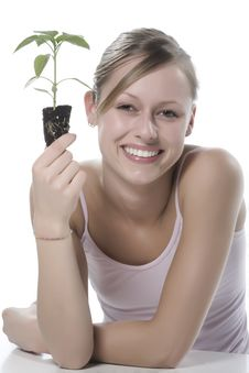 Free Young Woman Holding Young Sprout In The Hands. Stock Photos - 5172763