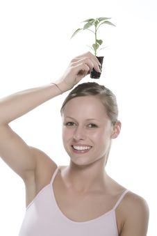 Young Woman Holding Young Sprout In The Hands. Royalty Free Stock Image