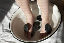 Free Feet In Wash-basin With Stones Stock Photo - 5173970