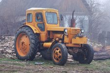 Free Yellow Tractor. Royalty Free Stock Photos - 5175178