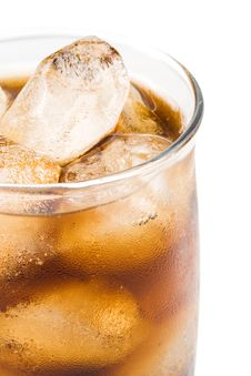 Cold Fizzy Cola With Ice Stock Images