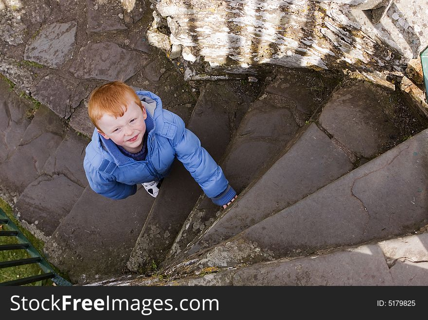 Boy on spiral stairs