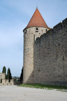 Lofty Tower And Defense Walls Of Castle Stock Photo