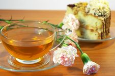 Cup Of Tea, Flowers And Cake Royalty Free Stock Photos