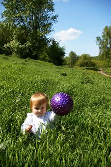 Free Girl Sits On A Grass With A Ball Stock Photo - 5182280