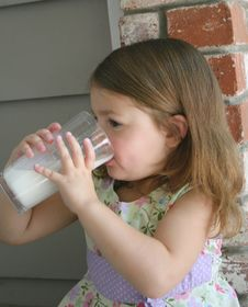 Girl Drinking Milk 1 Stock Image