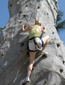 Young Lady Rock Climbing Royalty Free Stock Images
