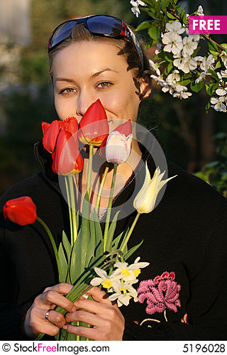 Free The Girl With A Bouquet Of Tulips Royalty Free Stock Photos - 5196028