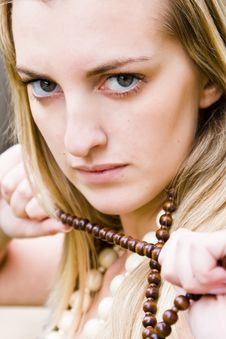 Free Blonde Holding A Necklace Royalty Free Stock Photo - 5192895