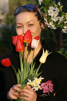 The Girl With A Bouquet Of Tulips Royalty Free Stock Photos