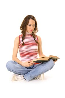 Sitting On The Floor And Reading Royalty Free Stock Image