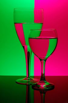 Free Two Glasses On Neon Background Royalty Free Stock Photography - 521847