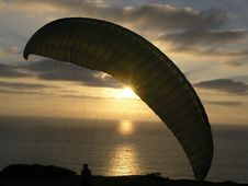 Hang Glider In Sunset Stock Photo