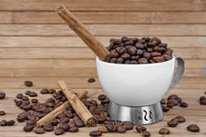 Free Cup, Coffee Beans And Cinnamon Stick Royalty Free Stock Photo - 5202265