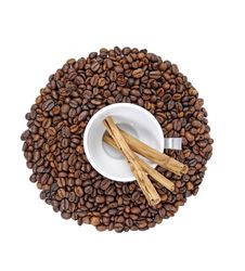 Free Coffee Beans, White Cup And Cinnamon Sticks Stock Images - 5202404