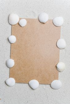 Free Rough Cardboard With Seashells On Sand Stock Image - 5206681