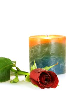 Free Single Red Rose With Droplets And Burning Candle Stock Photo - 5209210
