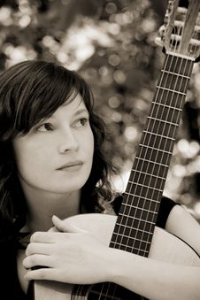 Free Woman Holding Guitar Stock Photo - 5209320