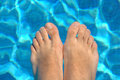 Free Feet In Water On Swimming Pool Stock Photography - 5211042
