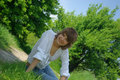Free Young Attractive Woman Sitting In A Path Royalty Free Stock Image - 5213236