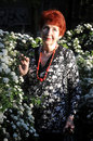 Free Senior Woman And White Flowers Royalty Free Stock Images - 5215099