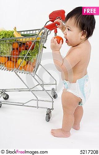 Free Baby Pushes A Shopping Cart Royalty Free Stock Photos - 5217208