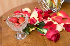 Tulip Petals And Strawberry On The Table Royalty Free Stock Images