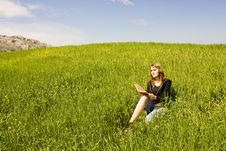 Free Blond Reading On Grass Royalty Free Stock Photos - 5210228