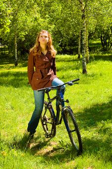 Young Woman On Bicycle In The Spring Forest Royalty Free Stock Images