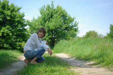 Free Young Attractive Woman Sitting In A Path Royalty Free Stock Images - 5213229