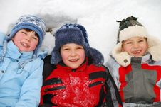 Children Laying In Snow Royalty Free Stock Images