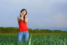Free Young Woman With Headphones In A Wheat Field Royalty Free Stock Photo - 5213895