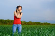 Free Young Woman With Headphones In A Wheat Field Royalty Free Stock Image - 5213906