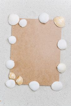 Free Rough Cardboard With Seashells On Sand Royalty Free Stock Image - 5213966